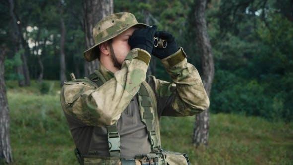 Cover Image for Man In Uniform Looking Through Binoculars