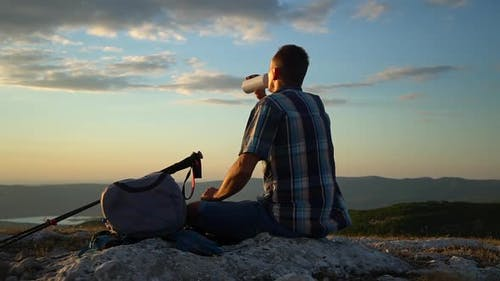 Travel Mountain Hike Young Male Hiker Drinking Water and Looking at Beautiful Natural Scenery in