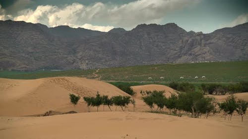 Combination of Desert, Meadows, Mountains and Yurt Camps