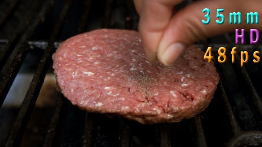 Cover Image for Seasoning Burgers On The Grill