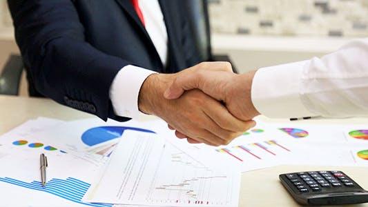 Thumbnail for Businessmen Shaking Hands