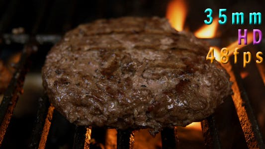 Thumbnail for Grilling And Flipping A Burger With Flames 05