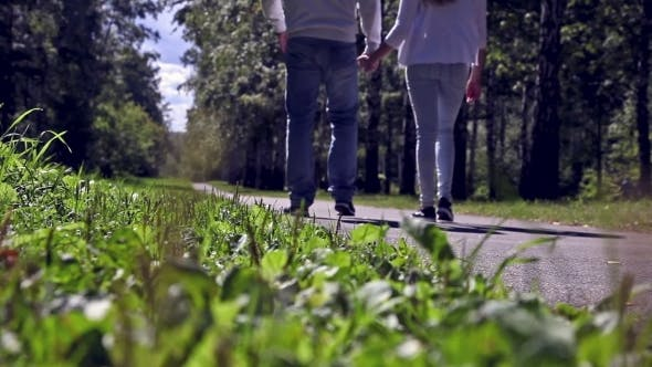 Thumbnail for Young Couple Walks On Sidewalk In Forest