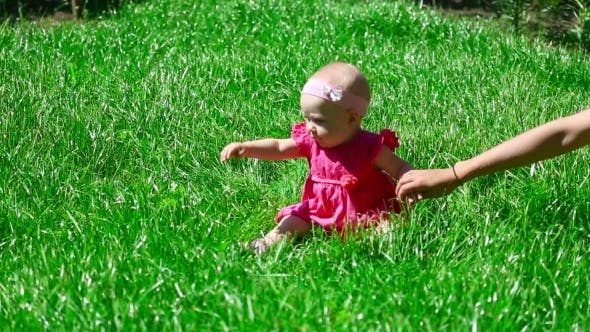 Thumbnail for Baby Girl On a Grass