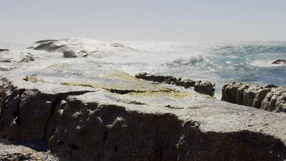Thumbnail for Pedestal Shot of Big Waves Hitting a Rocky Coastline on a Summer Day