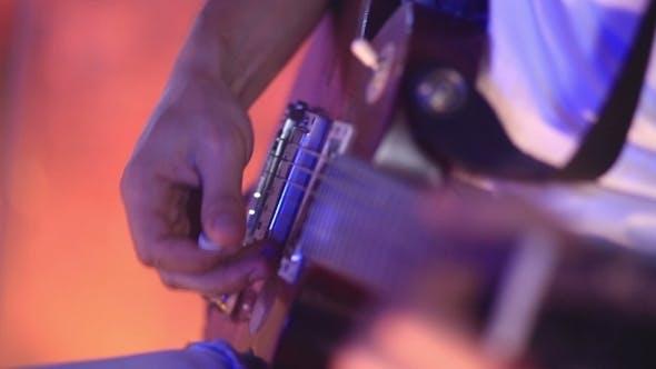 Thumbnail for Man Plaing Guitar