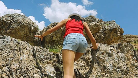 Cover Image for Woman in Mountain Climbing Rocks