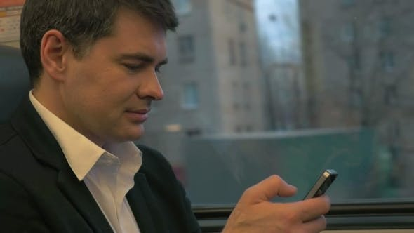 Thumbnail for Businessman Using Smartphone In Train
