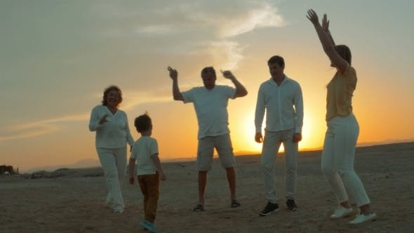 Thumbnail for Big Happy Family Dancing On The Beach At Sunset