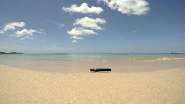 Cover Image for Smart Phone On The Beach In The Sea