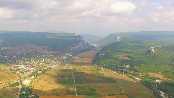 Thumbnail for Aerial Panorama Of Hilly Locality And Harvest