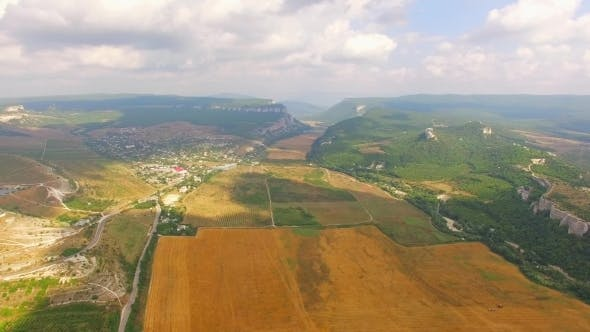 Thumbnail for Bird's Eye View Of Hilly Locality And Harvest