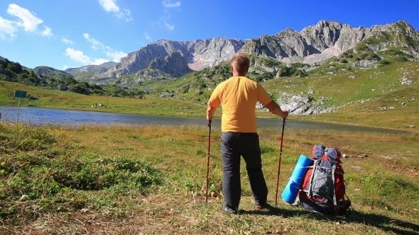 Thumbnail for Tourist Man In Mountain With Backpack