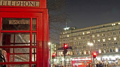 The Red Telephone Booth on the Side Walk