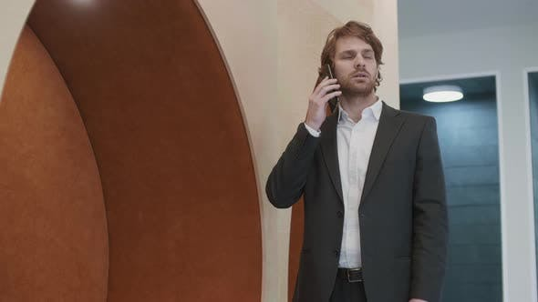 Thumbnail for Red-haired Businessman Having Telephone Conversation