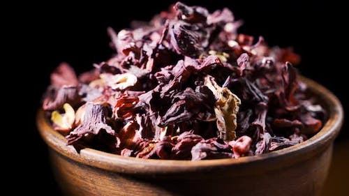 Dry Hibiscus Flowers Tea Rotation Texture Background From Sudanese Rose Karkade