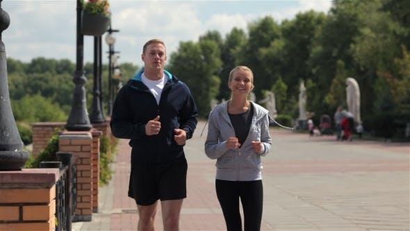 Thumbnail for Happy Young Friends Enjoying a Run Outdoors