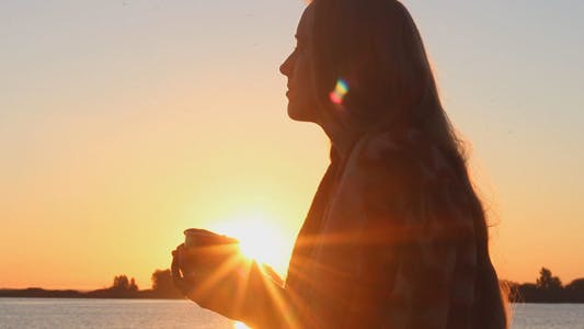Thumbnail for Beautiful Girl Admiring the Sunrise on the River