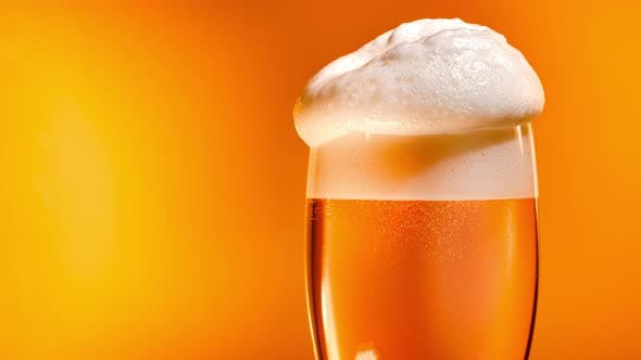 Thumbnail for Lager Beer Settles in the Glass with a White Cap of Foam