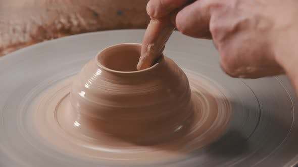 Thumbnail for Pottery - the Master Is Continuing To Spin Clay on the Wheel