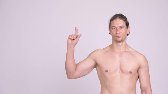 Thumbnail for Handsome Muscular Shirtless Man Thinking While Pointing Up