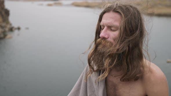 Bearded Man Meditates on Nature