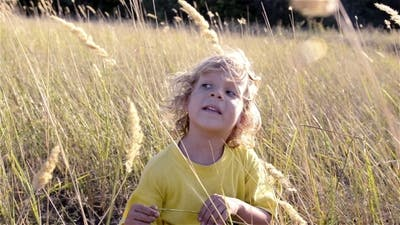 A Child Playing In The Grass
