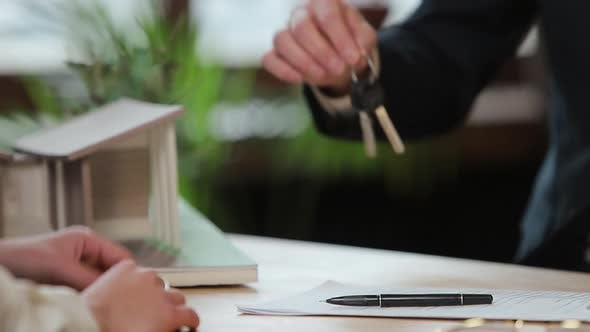 Thumbnail for Business, Real Estate, Deal and People Concept - Man Giving House Keys To Woman at Office