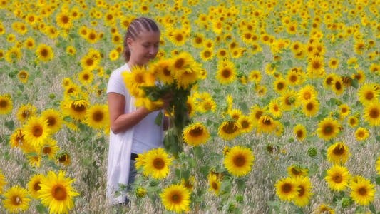 Thumbnail for Woman with bunch of sunflowers