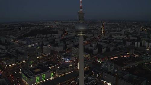 Over Berlin Germany TV Tower Alexanderplatz at Night with City Lights Traffic