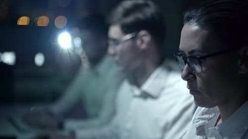Cyber Security Team Working at Night