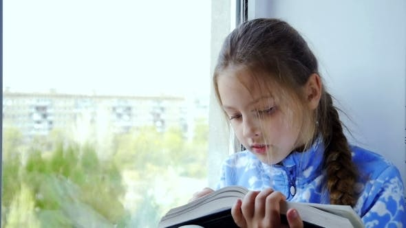 Thumbnail for Young Beautiful Girl Reading a Book