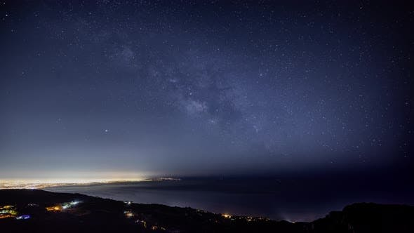 Thumbnail for Time Lapse of the night sky and the Milky Way rising over the lights of Los Angles