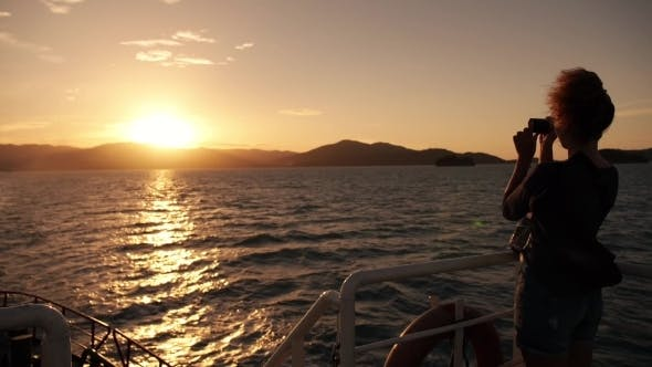 Thumbnail for Young Female Using Smartphone At Sea Sunset