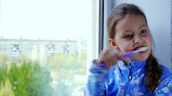Thumbnail for Girl Brushing Her Teeth With a Toothbrush