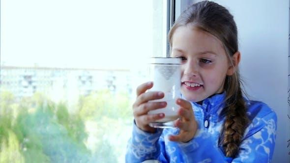 Thumbnail for Happy Little Child Drinking Milk
