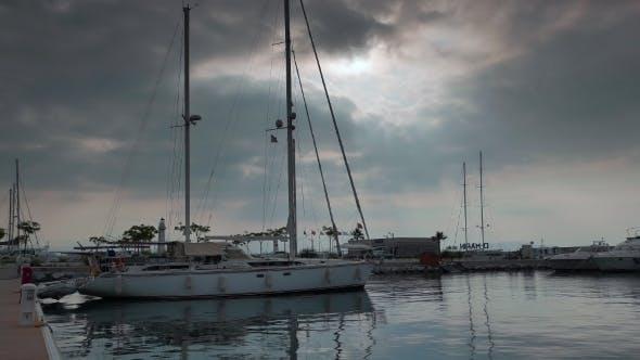 Thumbnail for Sailing Ketch Moored In Marina At Calm Morning