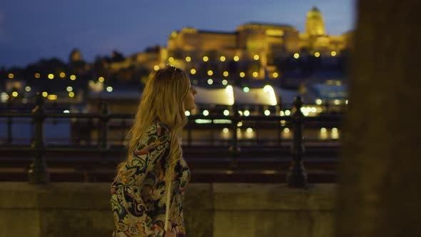 Thumbnail for Walking on the river bank, at dusk