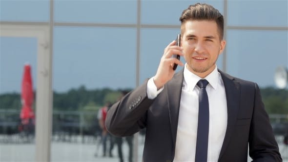 Thumbnail for Businessman Talking On His Cellphone