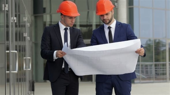 Cover Image for Two Architect Having a Conversation Outdoors