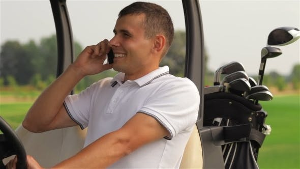 Thumbnail for Golfer Making a Call Outdoors