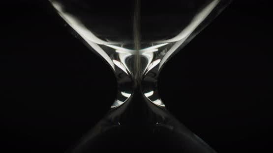 Sand moving in upside down hourglass