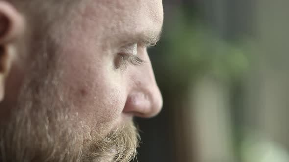 Thumbnail for Extreme Closeup Shot of a Bearded Man with Green Eyes and Long Lashes