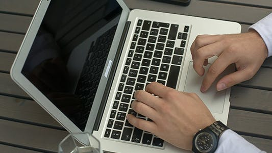 Thumbnail for Typing on a Laptop Close Up