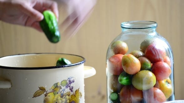 Thumbnail for Woman Lays Tomatoes And Cucumbers In Jars Home