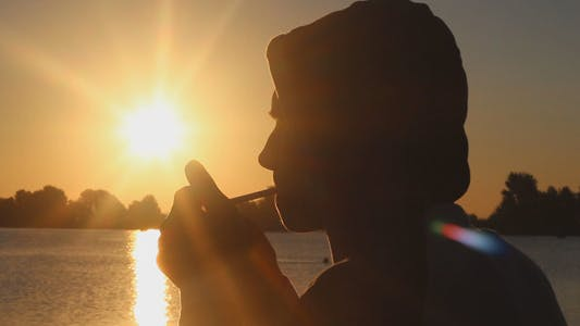 Thumbnail for Man Smoking a Cigarette and Admiring the Sunrise