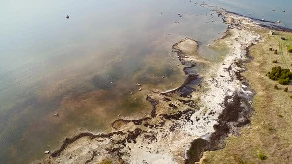 Thumbnail for Abstract aerial view of algae beach at coast side in Forby on the island of Vormsi in Estonia.