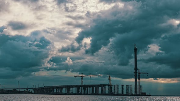 Thumbnail for Dramatic Clouds over a Bridge Under Construction
