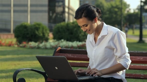 Thumbnail for Cheerful Girl With Laptop On The Bench