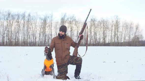 Thumbnail for Handsome Man Looking at His Tired Dog After Hunting